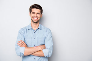 man smiling with arms crossed, about lovett dental baytown