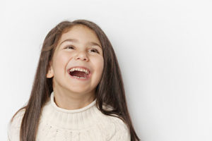 girl smiling with open mouth, pediatric dentistry baytown tx