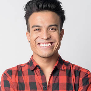 man in plaid smiling