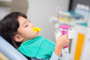child with a mouthguard in, fluoride treatments tx