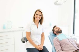 dentist sitting next to patient for preventative dentistry