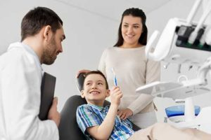 mother and son learning about family dentistry